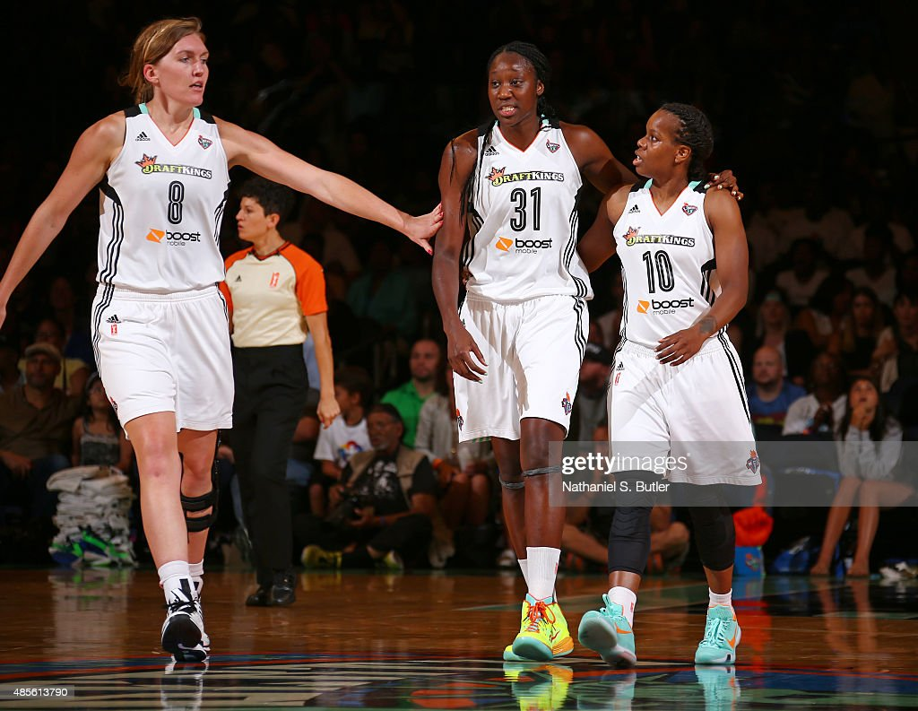 Teammates Carolyn Swords Tina Charles and Epiphanny Prince of the New York Liberty together during a game against the Minnesota Lynx on August 28...