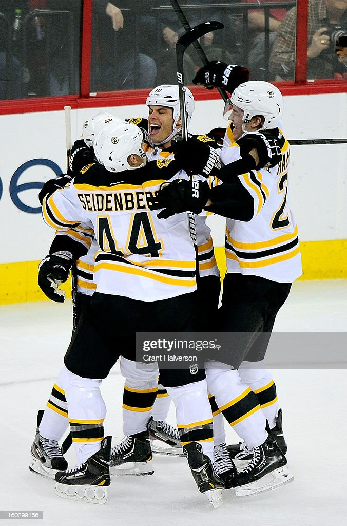 Teammates celebrate after the game-winning goal by David Krejci #46 of the Boston Bruins during the third period against the Carolina Hurricanes at PNC Arena on January 28, 2013 in Raleigh, North Carolina. The Bruins defeated the Hurricanes, 5-3.