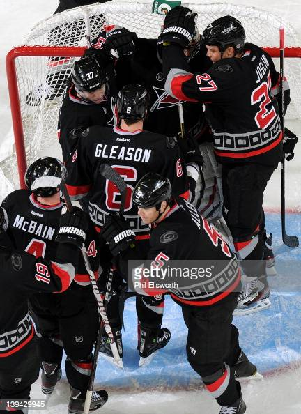 Teammates celebrate around goaltender Justin Peters following the Carolina Hurricanes 50 victory over the Washington Capitals during an NHL game on...