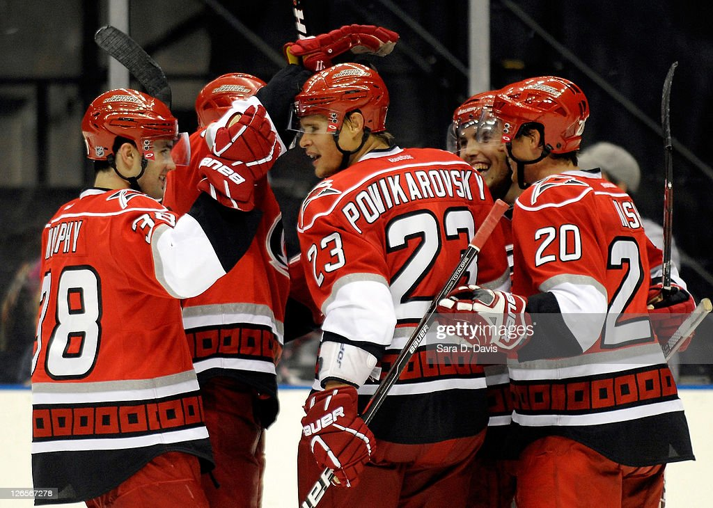 Teammates celebrate the goal by <a gi-track='captionPersonalityLinkClicked' href=/galleries/search?phrase=Alexei+Ponikarovsky&family=editorial&specificpeople=210628 ng-click='$event.stopPropagation()'>Alexei Ponikarovsky</a> #23 of Carolina Hurricanes during the second period during an NHL pre-season hockey game at the Time Warner Arena September 25, 2011 in Charlotte, North Carolina. Carolina won 4-0 over Winnipeg.
