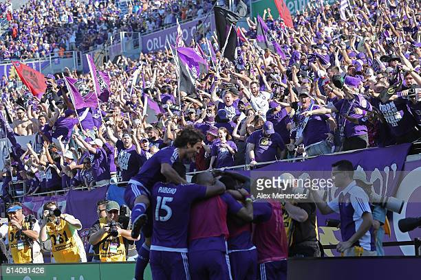 Teammates celebrate with Adrian Winter of Orlando City SC after his game tying goal in overtime during a MLS soccer match between Real Salt Lake and...