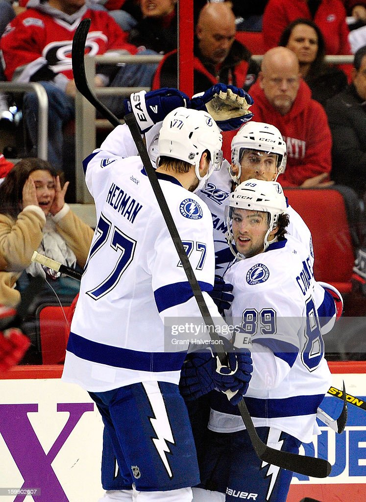 Teammates celebrate with Cory Conacher #89 of the Tampa Bay Lightning after his first period goal against the Carolina Hurricanes at PNC Arena on January 22, 2013 in Raleigh, North Carolina.