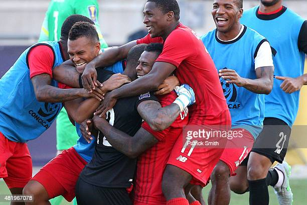 Teammates celebrate with goal keeper Luis Mejia of Panama after they defeated the United States in a penalty shootout during the CONCACAF Gold Cup...