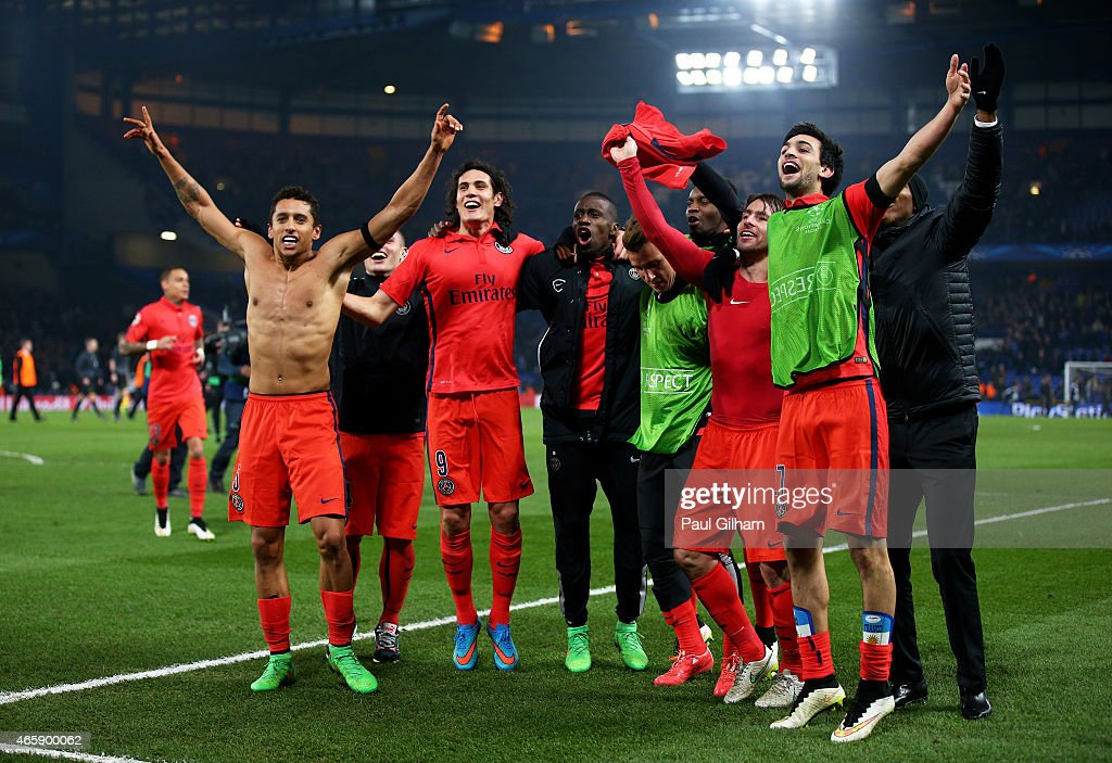 PSG teammates celebrates as their team go through on away goals following extra time during the UEFA Champions League Round of 16, second leg match between Chelsea and Paris Saint-Germain at Stamford Bridge on March 11, 2015 in London, England.