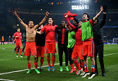 PSG teammates celebrates as their team go through on away goals following extra time during the UEFA Champions League Round of 16 second leg match...