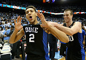 Teammates Chase Jeter and Marshall Plumlee of the Duke Blue Devils celebrate after defeating the North Carolina Tar Heels 7473 after their game at...