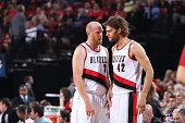 Teammates Chris Kaman and Robin Lopez of the Portland Trail Blazers talk during the game against the Utah Jazz on October 9 2014 at the Moda Center...
