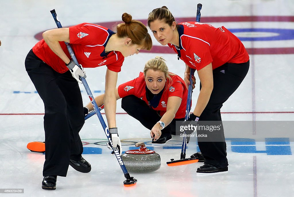 Teammates Claire Hamilton Anna Sloan and Vicki Adams of Great Britain compete against Japan during the Women's Curling Round Robin match on day seven...