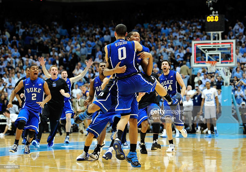 Teammates congratulate Austin Rivers of the Duke Blue Devils after his lastsecond gamewinning three point basket against the North Carolina Tar Heels...