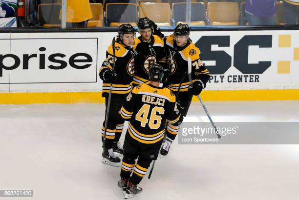 Teammates congratulate Boston Bruins left wing Anders Bjork after the second of his two goals during a game between the Boston Bruins and the...