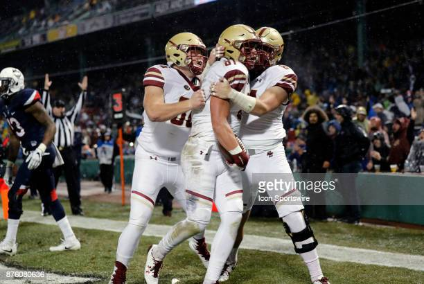 Teammates congratulate Boston College wide receiver Chris Garrison after his touchdown grab during a game between the UCONN Huskies and the Boston...