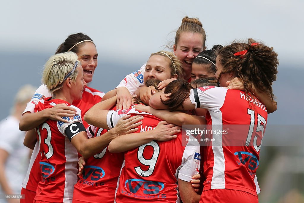 Teammates congratulate Emily Condon of Adelaide after she scored a goal during the round 11 WLeague match between Adelaide United and Western Sydney...