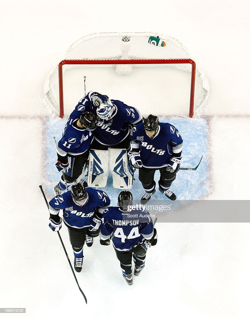 Teammates congratulate goaltender <a gi-track='captionPersonalityLinkClicked' href=/galleries/search?phrase=Anders+Lindback&family=editorial&specificpeople=7211274 ng-click='$event.stopPropagation()'>Anders Lindback</a> #39 on a win against the Ottawa Senators at the Tampa Bay Times Forum on January 25, 2013 in Tampa, Florida.
