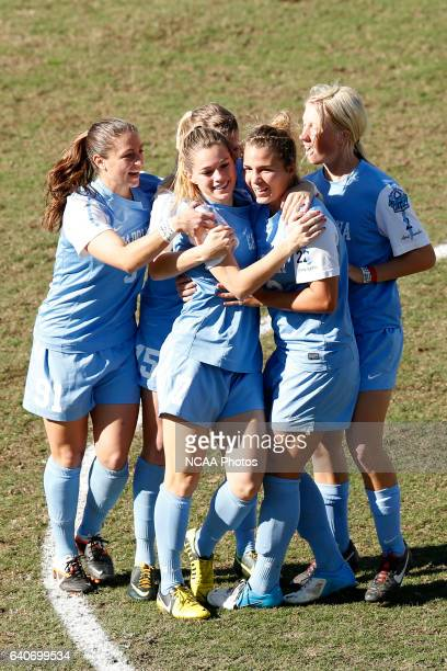 Teammates congratulate Kealia Ohai of the University of North Carolina on her goal against Penn State University during the Division I Women's Soccer...