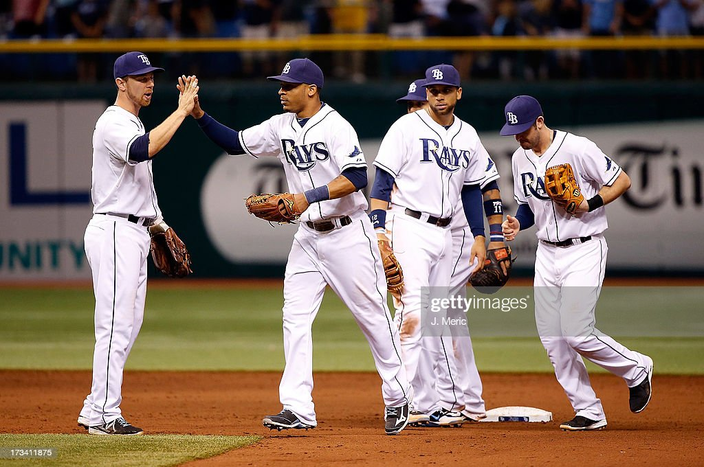 Teammates congratulate outfielder <a gi-track='captionPersonalityLinkClicked' href=/galleries/search?phrase=Desmond+Jennings&family=editorial&specificpeople=5974085 ng-click='$event.stopPropagation()'>Desmond Jennings</a> #8 of the Tampa Bay Rays after the Rays victory over the Houston Astros at Tropicana Field on July 13, 2013 in St. Petersburg, Florida.