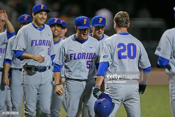 Teammates congratulate Peter Alonso of the Florida Gators after he hit a two run home run against the Miami Hurricanes on February 26 2016 at Alex...