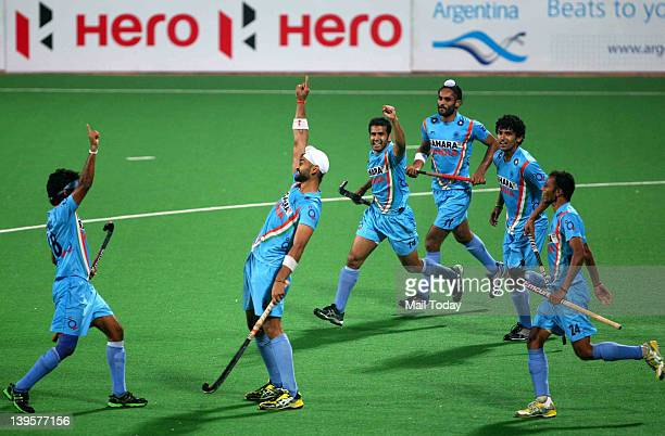 Teammates congratulate Sandeep Singh of India after scoring from a penalty corner during the men field hockey match between India and Canada of the...