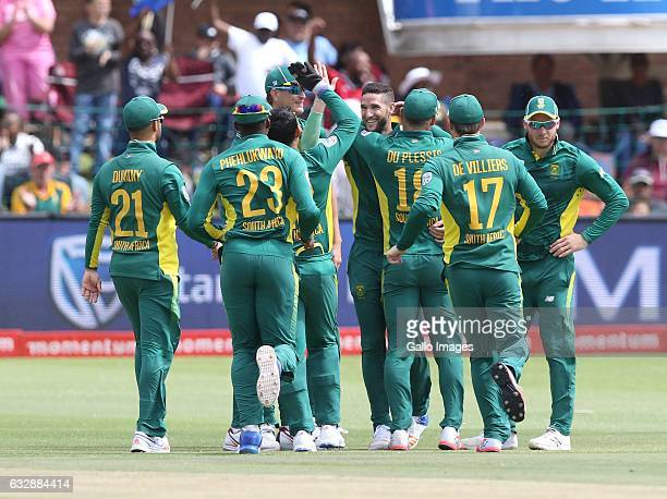 Teammates congratulate Wayne Parnell of South Africa for his removal of Niroshan Dickwella of Sri Lanka during the 1st One Day International match...