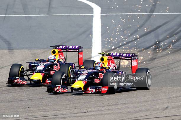 Teammates Daniel Ricciardo of Australia and Infiniti Red Bull Racing and Daniil Kvyat of Russia and Infiniti Red Bull Racing compete going into turn...