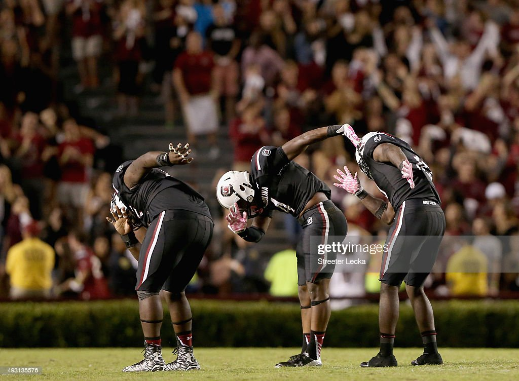 Teammates Dante Sawyer Bryson AllenWilliams and Skai Moore of the South Carolina Gamecocks react after a defensive stop during their game against the...