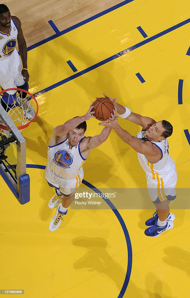 Teammates David Lee #10 and <a gi-track='captionPersonalityLinkClicked' href=/galleries/search?phrase=Andris+Biedrins&family=editorial&specificpeople=204473 ng-click='$event.stopPropagation()'>Andris Biedrins</a> #15 of the Golden State Warriors attempt to secure a rebound during a game against the Indiana Pacers on January 20, 2012 at Oracle Arena in Oakland, California.