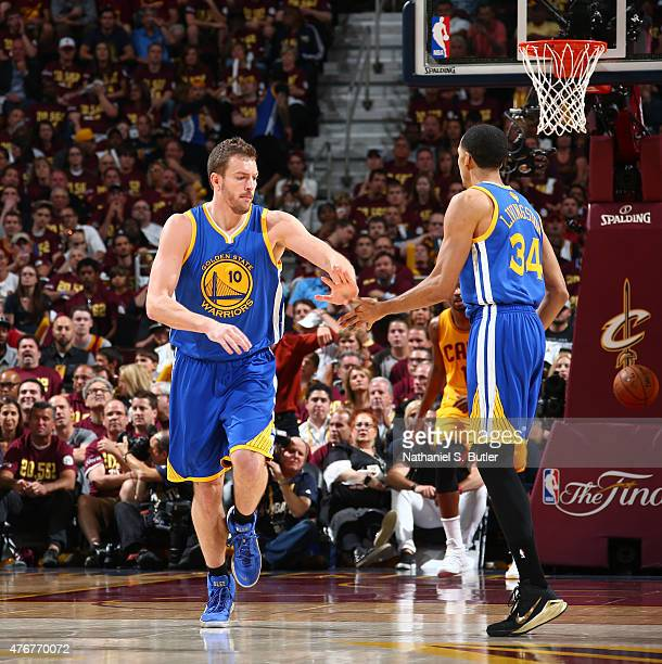 Teammates David Lee of the Golden State Warriors and Shaun Livingston of the Golden State Warriors highfive during Game Four of the 2015 NBA Finals...
