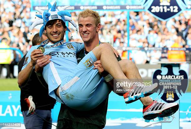Teammates David Silva and Joe Hart of Manchester City celebrate following the Barclays Premier League match between Manchester City and Queens Park...