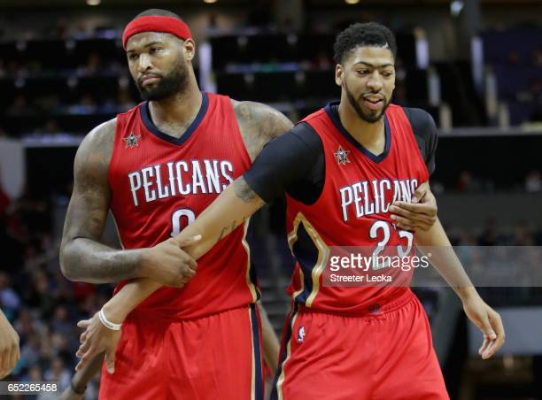 Teammates DeMarcus Cousins and Anthony Davis of the New Orleans Pelicans during their game against the Charlotte Hornets at Spectrum Center on March...