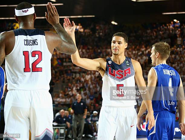 Teammates DeMarcus Cousins and Klay Thompson of the USA Basketball Men's National Team highfive during a game against the Finland Basketball Men's...
