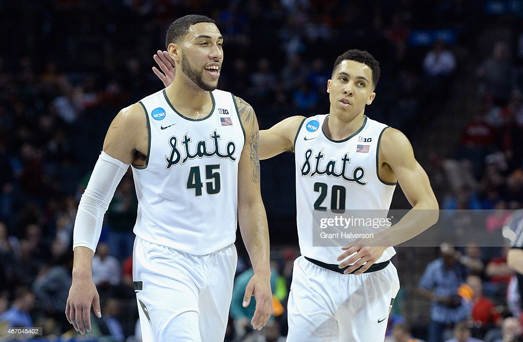Teammates <a gi-track='captionPersonalityLinkClicked' href=/galleries/search?phrase=Denzel+Valentine&family=editorial&specificpeople=9980674 ng-click='$event.stopPropagation()'>Denzel Valentine</a> #45 and <a gi-track='captionPersonalityLinkClicked' href=/galleries/search?phrase=Travis+Trice&family=editorial&specificpeople=8624391 ng-click='$event.stopPropagation()'>Travis Trice</a> #20 of the Michigan State Spartans react against the Georgia Bulldogs during the second round of the 2015 NCAA Men's Basketball Tournament at Time Warner Cable Arena on March 20, 2015 in Charlotte, North Carolina.