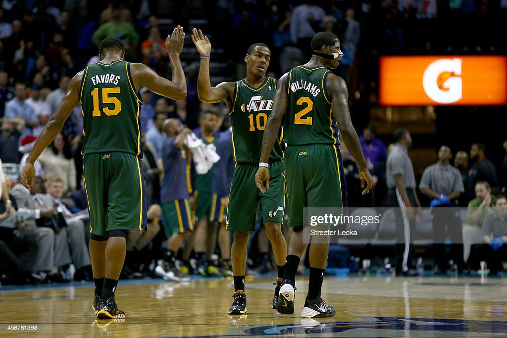 Teammates <a gi-track='captionPersonalityLinkClicked' href=/galleries/search?phrase=Derrick+Favors&family=editorial&specificpeople=5792014 ng-click='$event.stopPropagation()'>Derrick Favors</a> #15, <a gi-track='captionPersonalityLinkClicked' href=/galleries/search?phrase=Alec+Burks&family=editorial&specificpeople=6834208 ng-click='$event.stopPropagation()'>Alec Burks</a> #10 and <a gi-track='captionPersonalityLinkClicked' href=/galleries/search?phrase=Marvin+Williams&family=editorial&specificpeople=206784 ng-click='$event.stopPropagation()'>Marvin Williams</a> #2 of the Utah Jazz react after a play during their game against the Charlotte Bobcats at Time Warner Cable Arena on December 21, 2013 in Charlotte, North Carolina.