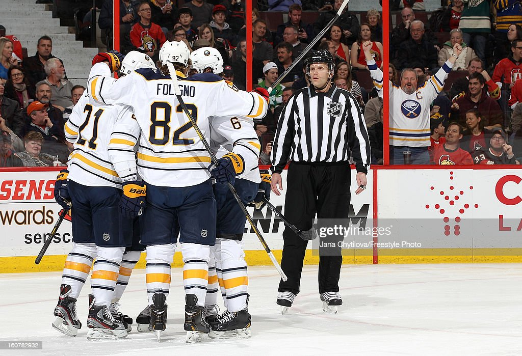Teammates Drew Stafford #21, Marcus Foligno #82 and Mike Weber #6 of the Buffalo Sabres celebrate a first period goal during an NHL game against the Ottawa Senators at Scotiabank Place on February 5, 2013 in Ottawa, Ontario, Canada.