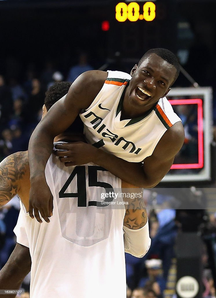Teammates Durand Scott #1 and Julian Gamble #45 of the Miami Hurricanes celebrate after defeating the North Carolina Tar Heels 87-77 during the finals of the Men's ACC Basketball Tournament at Greensboro Coliseum on March 17, 2013 in Greensboro, North Carolina.