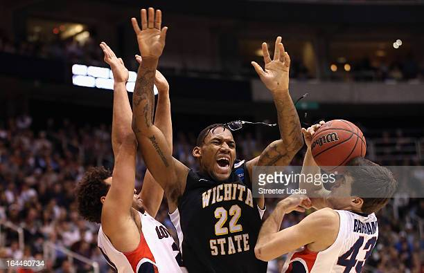 Teammates Elias Harris and Drew Barham of the Gonzaga Bulldogs foul Carl Hall of the Wichita State Shockers during the third round of the 2013 Men's...