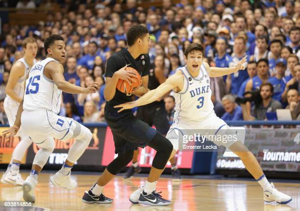 Teammates Frank Jackson and Grayson Allen of the Duke Blue Devils try to steal the ball from Cameron Johnson of the Pittsburgh Panthers during their...