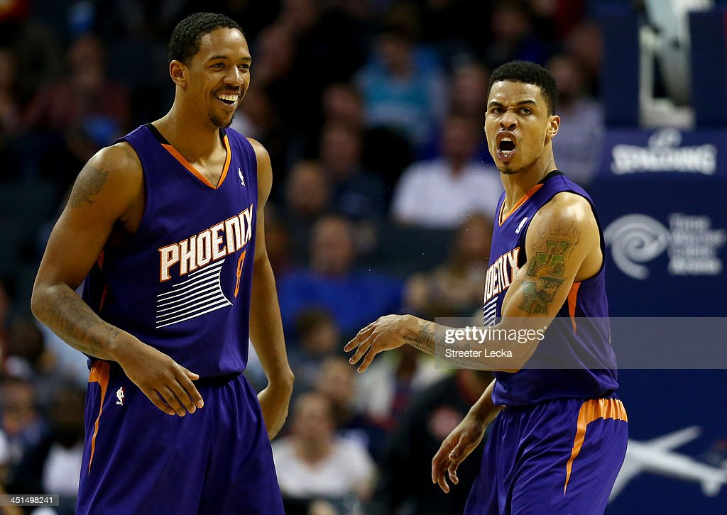 Teammates <a gi-track='captionPersonalityLinkClicked' href=/galleries/search?phrase=Gerald+Green&family=editorial&specificpeople=644655 ng-click='$event.stopPropagation()'>Gerald Green</a> #14 and <a gi-track='captionPersonalityLinkClicked' href=/galleries/search?phrase=Channing+Frye&family=editorial&specificpeople=206815 ng-click='$event.stopPropagation()'>Channing Frye</a> #8 of the Phoenix Suns react after a basket by Green during their game against the Charlotte Bobcats at Time Warner Cable Arena on November 22, 2013 in Charlotte, North Carolina.