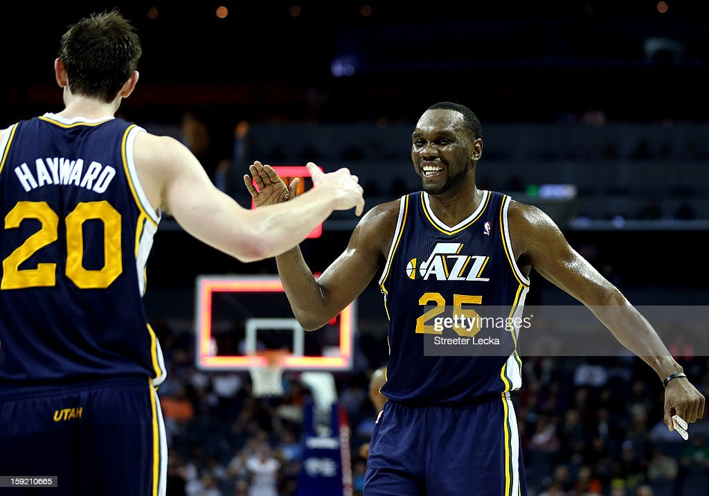 Teammates Gordon Hayward #20 of the Utah Jazz and Al Jefferson #25 react after a shot during their game against the Charlotte Bobcats at Time Warner Cable Arena on January 9, 2013 in Charlotte, North Carolina.
