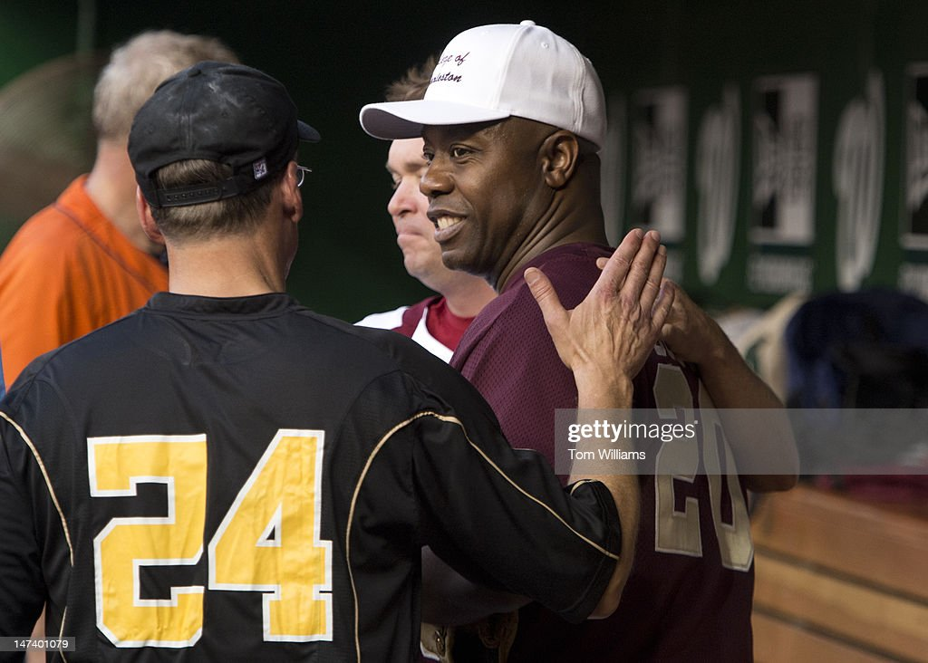 Teammates greet Rep. Tim Scott, R-S.C., right, back in the dugout after he pitched in the 51st Annual CQ Roll Call Congressional Baseball Game held at Nationals Park. The Democrats prevailed over the Republicans 18-5.