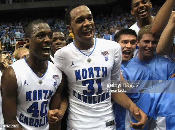 Teammates Harrison Barnes and John Henson of the North Carolina Tar Heels celebrate winning the ACC Regular Season Championship as they defeated the...