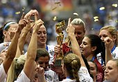 USA teammates hold the trophy following the teams' win in the final 2015 FIFA Women's World Cup match between USA and Japan at the BC Place Stadium...