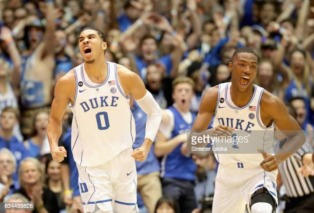 Teammates Jayson Tatum and Harry Giles of the Duke Blue Devils react after a play during their game against the North Carolina Tar Heels at Cameron...