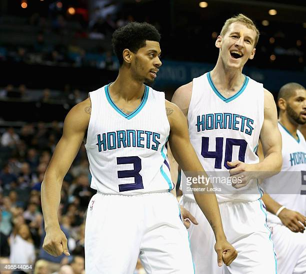 Teammates Jeremy Lamb and Cody Zeller of the Charlotte Hornets reacts after a basket during their game against the Chicago Bulls at Time Warner Cable...