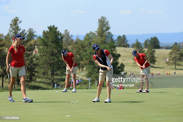 Teammates Jessica Korda Paula Creamer Morgan Pressel and Cristie Kerr of the USA putt on the 15th green during the 2013 Solheim Cup on August 14 2013...