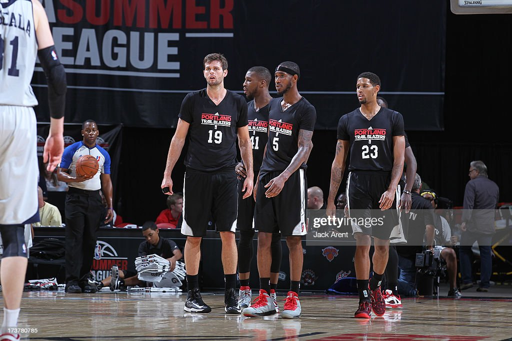 Teammates Joel Freeland #19, Thomas Robinson #41, Will Barton #5, Allen Crabbe #23 look on during the NBA Summer League game between the Atlanta Hawks and the Portland Trail Blazers on July 17, 2013 at the Thomas & Mack Center in Las Vegas, Nevada.