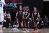 Teammates Joel Freeland Thomas Robinson Will Barton Allen Crabbe look on during the NBA Summer League game between the Atlanta Hawks and the Portland...