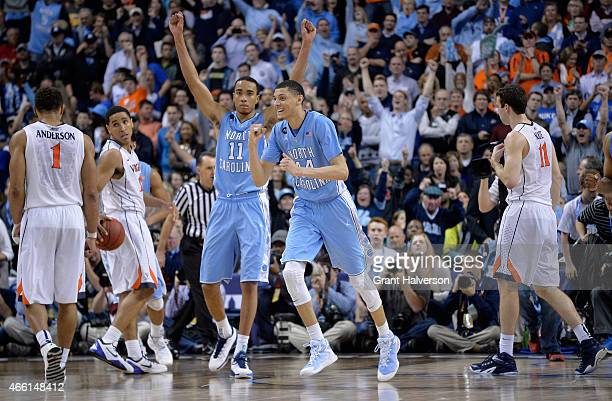 Teammates Justin Jackson and Brice Johnson of the North Carolina Tar Heels react against the Virginia Cavaliers during the semifinals of the 2015 ACC...