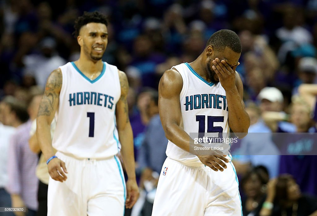 Teammates Kemba Walker #15 and Courtney Lee #1 of the Charlotte Hornets react after a call against the Miami Heat during game six of the Eastern Conference Quarterfinals of the 2016 NBA Playoffs at Time Warner Cable Arena on April 29, 2016 in Charlotte, North Carolina.