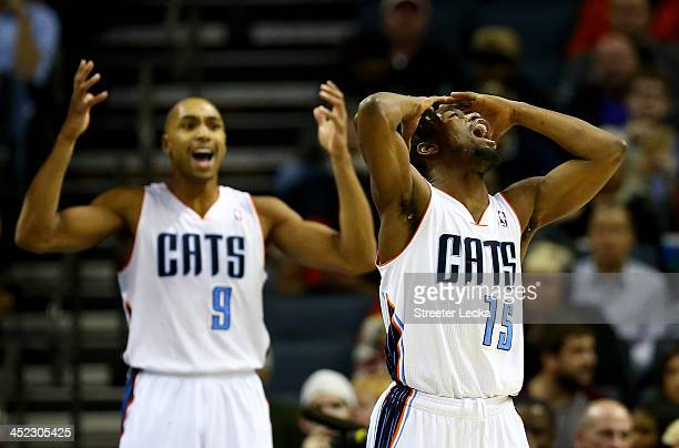 Teammates Kemba Walker and Gerald Henderson of the Charlotte Bobcats react after a call during their game against the Indiana Pacers at Time Warner...