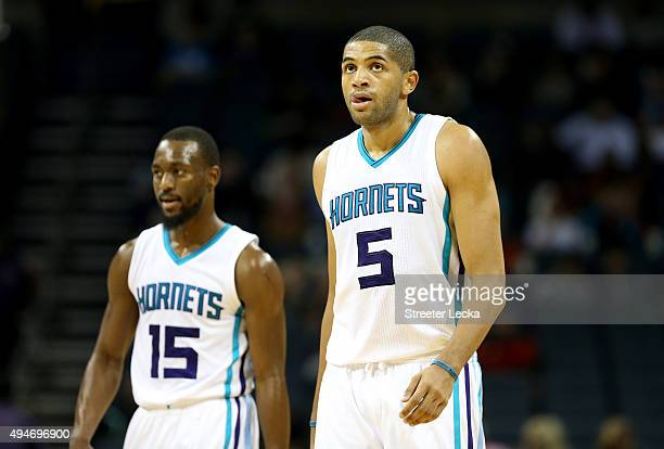 Teammates Kemba Walker and Nicolas Batum of the Charlotte Hornets during their game at Time Warner Cable Arena on October 19 2015 in Charlotte North...