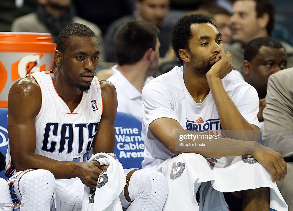 Teammates Kemba Walker #15 of the Charlotte Bobcats and Gerald Henderson #9 sit dejected on the bench during their game against the Indiana Pacers at Time Warner Cable Arena on January 15, 2013 in Charlotte, North Carolina.
